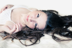 Brown-haired woman lying Stock Photo