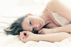 Brown-haired woman lying Stock Image