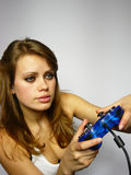 Brown-haired woman plays video game. Young nice girl plays video game Royalty Free Stock Photo