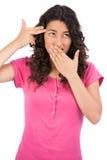 Brown haired woman posing making gun gesture Stock Image