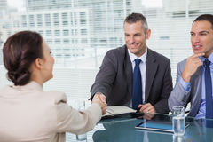 Brown haired woman shaking hands with her future employer Stock Images