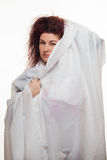 Brown-haired woman in a white sheet Royalty Free Stock Photography