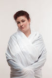 Brown-haired woman in a white sheet Stock Images