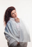 Brown-haired woman in a white sheet Stock Image