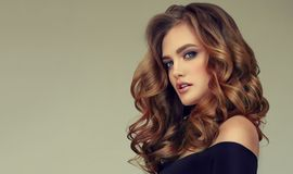 Free Brown Haired Woman With Voluminous, Shiny And Curly Hairstyle.Frizzy Hair. Stock Photography - 110297782