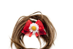 Brown hairpiece with red loop Stock Photo
