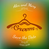 Brown hangers with groom word and moustache over colorful blurred background. Royalty Free Stock Photos