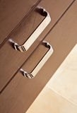 Brown hardwood drawers with metal handle. Top view royalty free stock photos