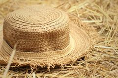 A brown hat on a rice straw. Stock Photos