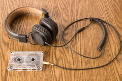 Brown headphones with long rubber cable connected Stock Photo