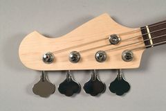 Brown headstock bass guitar Stock Images