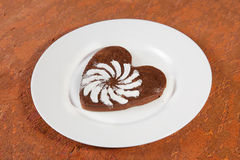 Brown heart shaped cookie with sugar powder Royalty Free Stock Photos