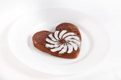 Brown heart shaped cookie with sugar powder Stock Photography