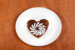 Brown heart shaped cookie with sugar powder Stock Images