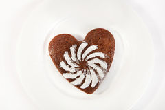 Brown heart shaped cookie with sugar powder Royalty Free Stock Image