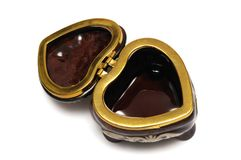 A brown heart shaped jewel box Stock Photography