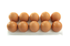 Brown hen's eggs in egg flat. Isolated over white Stock Photo