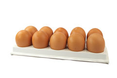 Brown hen's eggs in egg flat. Isolated over white Stock Photography