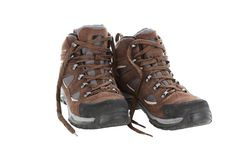 Brown hiking boots isolated on a white background stock photo