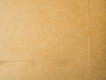 Brown-Hintergrund von den Papierumschlägen Stockfotos