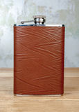 Brown hip flask Stock Images