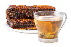 Brown honey in honeycombs to tea Stock Photography