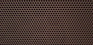 Brown Honeycomb Pattern Background - Audio Speaker Metal Grille with Small Holes - Top View royalty free stock photography