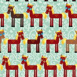 Brown horse on a blue floral background seamless pattern.  Royalty Free Stock Photography