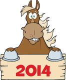 Brown Horse Looking Over A Blank Wood Sign With Numbers 2014 Stock Photos