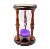 Brown hourglass with violet sand isolated on white backghound Royalty Free Stock Image