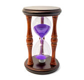Brown hourglass with violet sand isolated on white backghound Royalty Free Stock Photo