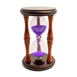 Brown hourglass with violet sand isolated on white backghound Stock Images