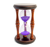 Brown hourglass with violet sand isolated on white backghound. Photo of brown hourglass with violet sand isolated on white background Royalty Free Stock Photos