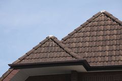 Brown house  roof. With brown roof bricks Royalty Free Stock Photography