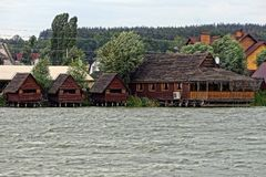 Brown houses made of wood above the water Stock Image