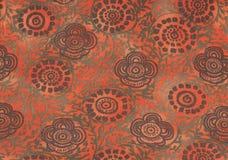 Brown i zieleni retro kwiaty na pomarańczowym tle fotografia royalty free