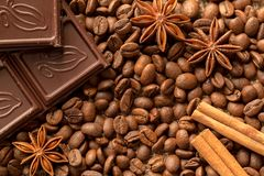Brown ingredients macro: anise star, cinnamon sticks and coffee beans. Top view royalty free stock photography