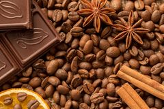 Brown ingredients macro: anise star, cinnamon sticks and coffee beans. Top view stock images