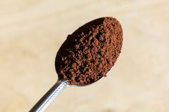 Brown instant coffee powder. Dry brown instant coffee powder, close up stock images