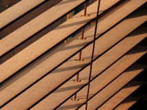 Brown interior wooden blinds. Brown wooden blinds with sunlight shining through stock photo
