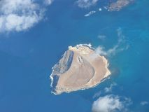 Brown island. Island in the middle of the ocean Stock Photos