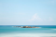 Brown Island in Body of Water Under Clear Blue Sky during Daytime Royalty Free Stock Image