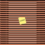 Brown jalousies. Wooden blinds with a sheet of paper Stock Photography