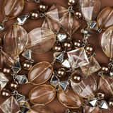 Brown jewel texture. Transparent brown jewel texture on brown background Royalty Free Stock Images