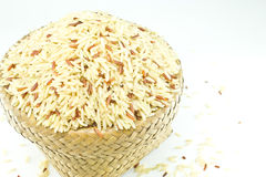 Brown jusmine rice, jute basket Stock Image
