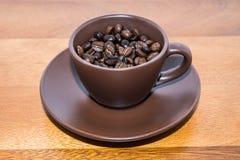 Brown kawa W filiżance Zdjęcie Royalty Free