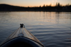 Brown Kayak in a Body of Water Stock Images