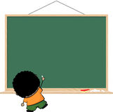 Brown kid writing on blank blackboard Royalty Free Stock Image