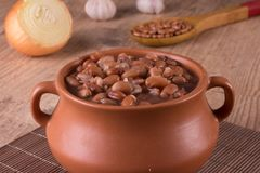 Brown Kidney Beans. Carioca into a pan. Over a wooden table stock photo