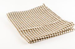 Brown kitchen towel. On a white background Royalty Free Stock Photo